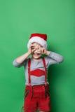 Naughty kid dressed like christmas elf Stock Photos