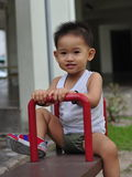 Naughty kid with seesaw Stock Image