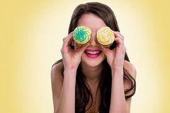 Naughty lady plays with cupcakes Royalty Free Stock Image