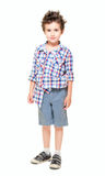 Naughty little boy in shorts Stock Image