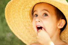 Naughty little boy in straw hat Royalty Free Stock Image