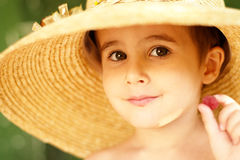 Naughty little boy in straw hat Stock Photo