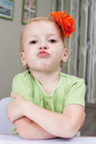 Naughty little girl. Cute little girl is grimacing Royalty Free Stock Photo