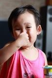 The naughty little girl. Stock Photo