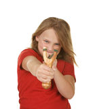 Naughty little girl with a slingshot. On white stock photo