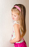 Naughty little girl is standing in the corner Stock Image