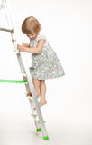 The naughty little girl walking down the stepladder Royalty Free Stock Images