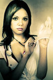 Naughty Nurse. A Healthcare Nurse Provocatively Puts On Rubber Gloves During A Not So Routine Medical Checkup In A Naughty Nurse Conceptual Royalty Free Stock Images