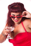 Naughty pinup looking over her glasses Stock Photo