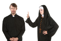 Naughty Priest. A young Catholic priest and nun bursting in laughter Royalty Free Stock Photography