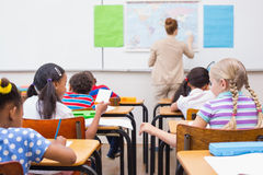 Naughty pupil in class Stock Images