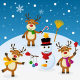 Naughty Reindeer and Snowman. Three spiteful cartoon Christmas reindeer playing with a snowman, in a snowy scene. Eps file available Stock Image