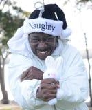 Naughty Santa Choking The Easter Bunny Stock Photography