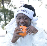 Naughty Santa Eating A Pumpkin.  Royalty Free Stock Images