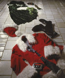 Naughty Santa partying with Mrs. Claus Stock Image