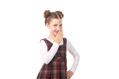 Naughty school girl. Portrait of naughty little girl in school uniform against white background Royalty Free Stock Images
