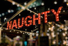 Naughty Sign in Lights Royalty Free Stock Image