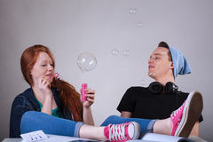 Naughty teenagers let bubbles at school. Naughty teenagers boring and let bubbles at school Stock Images