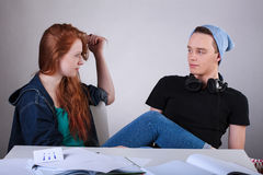 Naughty teenagers talking in classroom Royalty Free Stock Photo