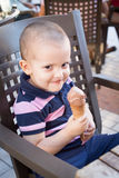 Naughty toddler eating ice cream Royalty Free Stock Photography