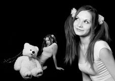 Naughty young woman with the big toy a polar bear Stock Photos