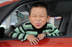 A naugthy boy making face Royalty Free Stock Images