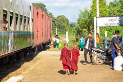 NAUNG HUIO, MYANMAR - November 16, 2015:young monks leaving the trai Royalty Free Stock Image