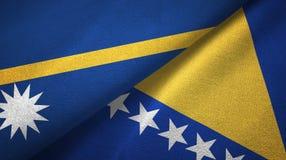 Nauru, Bośnia i Herzegovina dwa flagi tekstylny płótno, tkaniny tekstura zdjęcia royalty free