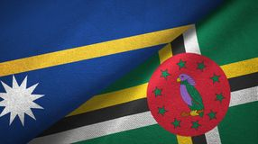 Nauru and Dominica two flags textile cloth, fabric texture. Nauru and Dominica two folded flags together stock image