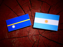Nauru flag with Argentinian flag on a tree stump isolated Stock Images