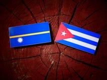 Nauru flag with Cuban flag on a tree stump isolated Royalty Free Stock Photo
