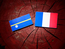 Nauru flag with French flag on a tree stump isolated Stock Image