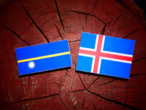 Nauru flag with Icelandic flag on a tree stump isolated Royalty Free Stock Image