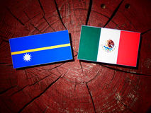 Nauru flag with Mexican flag on a tree stump isolated Stock Images