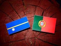 Nauru flag with Portuguese flag on a tree stump isolated. Nauru flag with Portuguese flag on a tree stump royalty free illustration