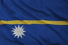Nauru flag printed on a polyester nylon sportswear mesh fabric w. Ith some folds royalty free stock image