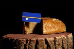 Nauru flag on a stump with bread Royalty Free Stock Image