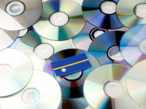 Nauru flag on top of CD and DVD pile isolated on white Stock Images