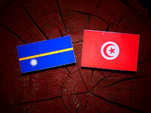 Nauru flag with Tunisian flag on a tree stump isolated Royalty Free Stock Image