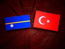 Nauru flag with Turkish flag on a tree stump  Royalty Free Stock Photography