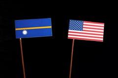 Nauru flag with USA flag isolated on black Stock Image