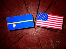 Nauru flag with USA flag on a tree stump  Stock Photos