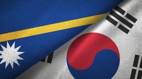 Nauru and South Korea two flags textile cloth, fabric texture. Nauru and South Korea flags together textile cloth, fabric texture stock images