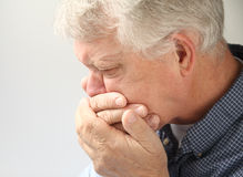 Nauseated senior man Stock Photos