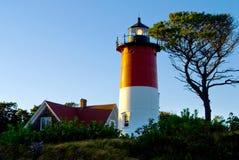 Nauset Lighthouse Lantern Shines Brightly at Dusk. Royalty Free Stock Photos