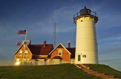 Naushon lighthouse at sunset Royalty Free Stock Images