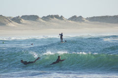 Nautic sports in Baleal, Portugal: bodyboard and paddle surfing. Water sports in Atlantic Ocean, Baleal bay, Peniche municipality, Leiria district, Portugal Stock Photo