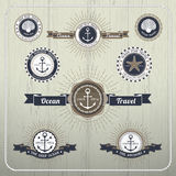 Nautical anchor travel labels with ray burst and ribbon Royalty Free Stock Image