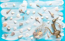 Nautical background fishing net sea shells vessel Maritime flat. Nautical background with fishing net, sea shells, golden vessel on turquoise blue painted wooden Stock Photos