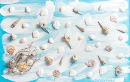 Nautical background fishing net sea shells Maritime flat lay. Nautical background with fishing net, sea shells on turquoise blue painted wooden board. Maritime Royalty Free Stock Photography